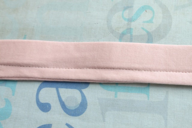 14 pin the waistband to the skirt the band should be on the outside